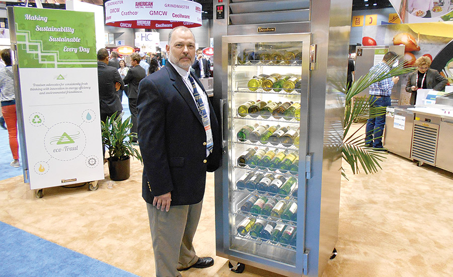 WINE UNIT: Scott Mallernee, sales development manager, Traulsen, poses with one of the company�¢??s refrigerated wine units during a recent trade show event.