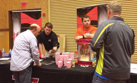 WARRANTY WORK: Representatives from JB & Associates discuss the benefits of extended warranties with contractors at a trade show.