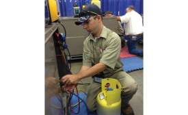 Contestant 511 competes in the refrigerant troubleshooting station where he is required to identify refrigerants and demonstrate proper recovery procedures.
