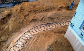 SLINKY COILS: The all-geothermal neighborhood of Rivera Greens uses slinky coils, which are stacked in a horizontal trench. Photo courtesy of WaterFurnace