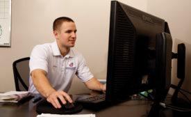 Adam Saunders, sales manager, Air Quality Dunrite, Toronto, reviews an order prior to dispatching a team of technicians.