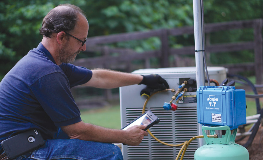WIRELESS HELP: The Sporlan SMART service tool helps Ralph Wolf, T&N Services LLC, diagnose and service equipment in the field.