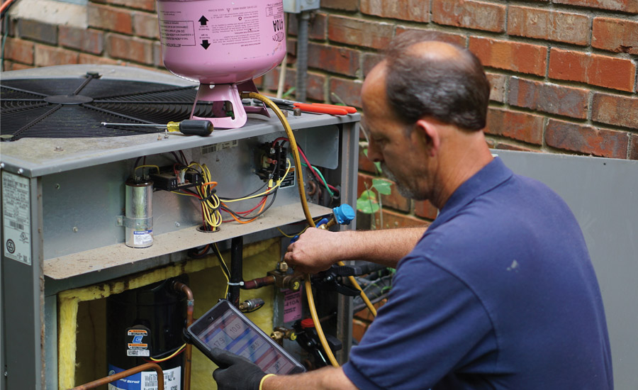 SMART TOOL: Ralph Wolf from T&N Services LLC, Canton, Georgia, uses the Sporlan SMART service tool on a service call.