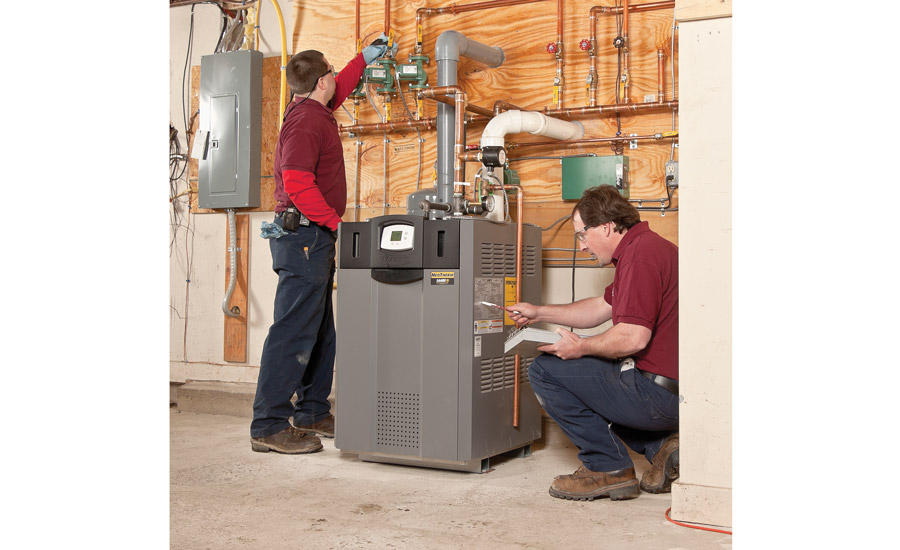 MAKING A LIST: As technicians button-up a completed light commercial hydronic system, satisfactory venting is on the checklist.