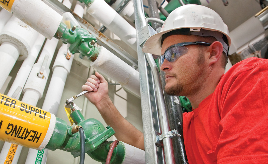 WATCHING THE WATER: Scot Walston, head service technician for Proctor Mechanical Corp., DesMoines, Iowa, adjusts the water flow through a Taco Inc. balancing valve.