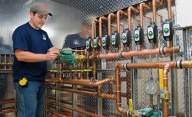 A technician wdith Woburn, Massachusetts-based Central Cooling & Heating Inc. completes a hydronic installation at a custom home near Boston.
