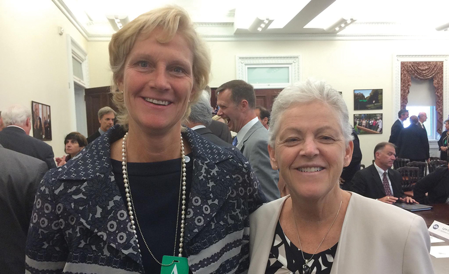 Laura Wand (left), vice president of global chiller solutions at Johnson Controls' building efficiency business, and U.S. Environmental Protection Agency (EPA) administrator Gina McCarthy (right) pose for a photo at the roundtable event.