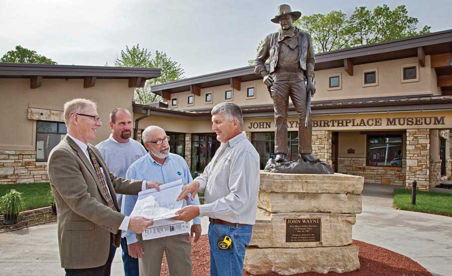 Mark Thiessen, architect, Angelo Architectural Associates; Sherman; Burhans; and Dan Bush, owner of New Castle Enterprises discuss the blueprints while on location at the John Wayne Museum.