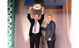 John Galyen, president, Danfoss North America (left), receives the 2015 Chairman's Challenge award from AHRI Chairman Ed Purvis.