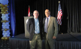 Matt Michel (left), CEO and chairman of Service Nation, and Matt Eversmann (right) pose for a photo during the kickoff keynote address on Sept. 14.