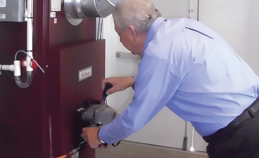 HANDS-ON: An instructor at the Pennsylvania Petroleum Association (PPA) training facility demonstrates how to service an oil furnace.