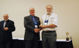 MEMBER OF THE YEAR: Robert J. Sherman, (right) receives the RSES Member of the Year Award from RSES international president Harlan Krepcik (left).
