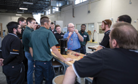 Instructor Frank Diaz provides instruction to students inside the One Hour Air Conditioning & Heating Technical Training Center at Suncoast Technical College.