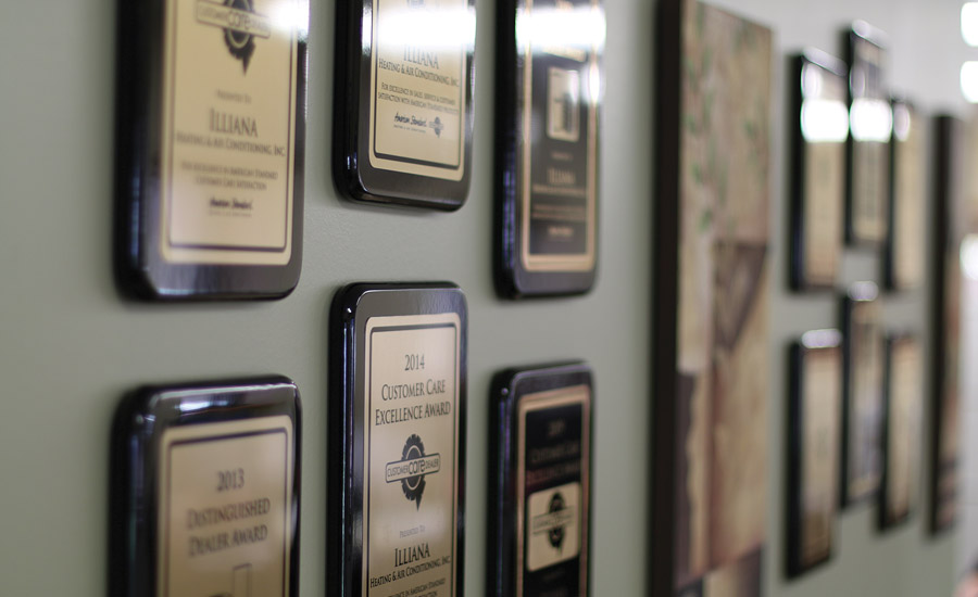 The walls at Illiana Heating & Air Conditioning are decorated with numerous awards the company's accumulated over the last 28 years.