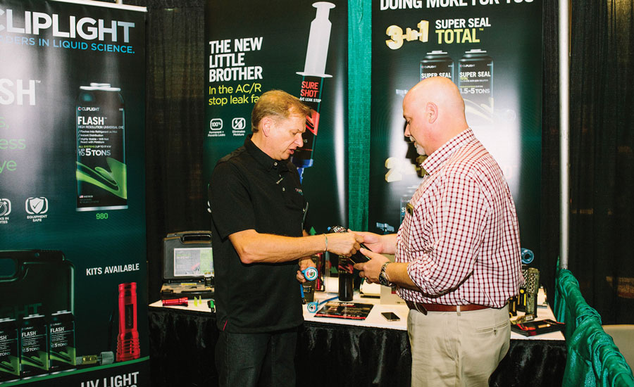 Paul Appler, director of research and development for Cliplight showcases product on the event's trade show floor.