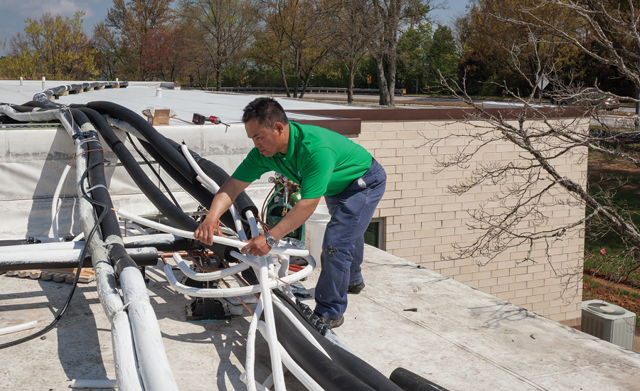 Most refrigerant lines at St. James were double insulated and run across the building's flat roof.