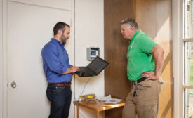 Jackson Willis (left), Mid-Atlantic sales engineer for Fujitsu General America Inc., and Alan Stephens (right), owner of Eco-Green Air in Raleigh, North Carolina, discuss how they plan to approach the installation