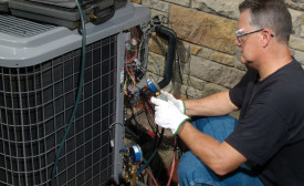 An HVAC technician retrofits a residential air conditioning unit from R-22 to Freon™ MO99. Photo courtesy of the Chemours Co.