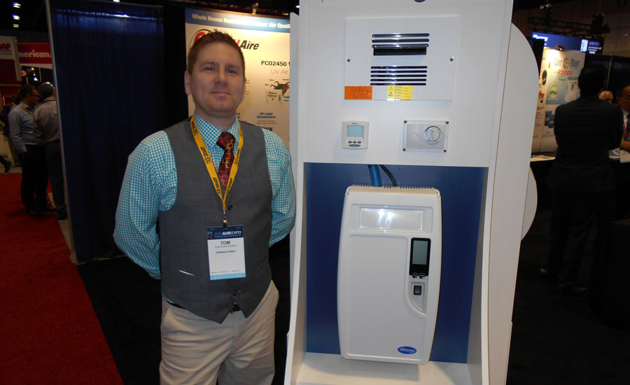 Tom Christensen, tech support and in-house contractor, General Filters, shows off the company's DS15 electrode steam humidifier.