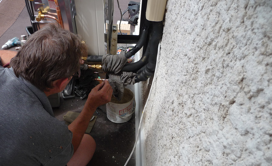 A technician brazes an R-410A refrigerant line. Proper installation techniques help prevent leaks in refrigeration and air conditioning systems. Photo courtesy of D. Brian Baker, Custom Vac Ltd.
