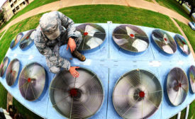 checking an HVAC system at Barksdale Air Force Base