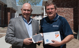 Shown above, Rectorseal's New England territory manufacturer's representative, Robert Forbes (left), a partner with Gimper Forbes LLC in Edison, New Jersey, presents Clarke (right) with the iPad Mini 3.