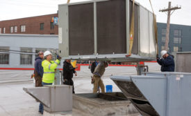A Modine Atherion unit is lowered onto a roof curb atop North Market in Columbus, Ohio.