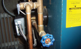Before drawing off the boiler's old water, pour a pint or so of oil on the surface of the water in the expansion tank, which is always to be found at the highest point in the system.