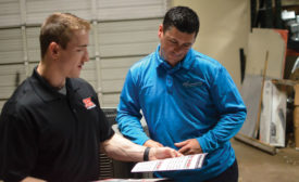 Bobby Gillespie (left), inside sales, JB & Associates, discusses extended warranty options with Roland LeTeff (right) of Ray's Emergency Air, Dallas. PHOTO COURTESY OF JB & ASSOCIATES.
