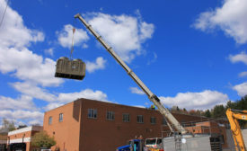 cooling tower being raised onto roof