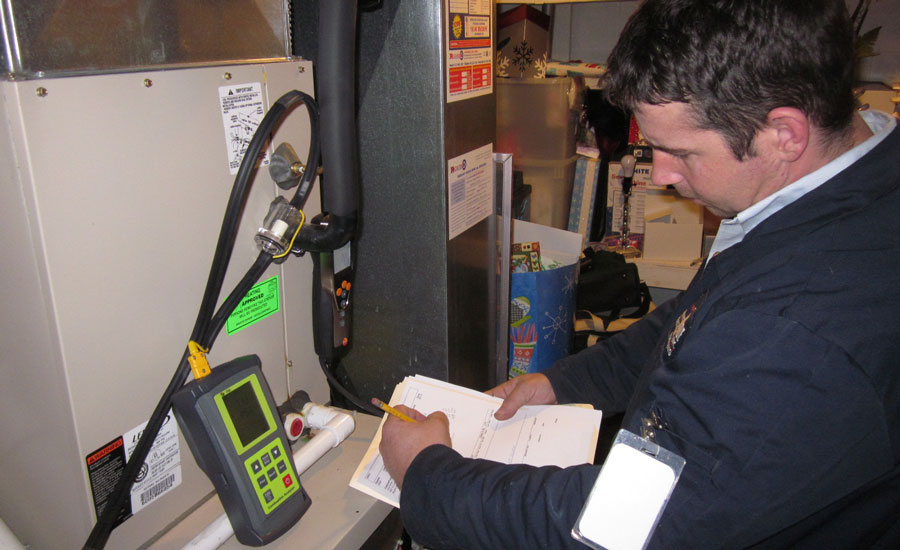 Lakeside-technician-performing-combustion-testing-during-an-audit