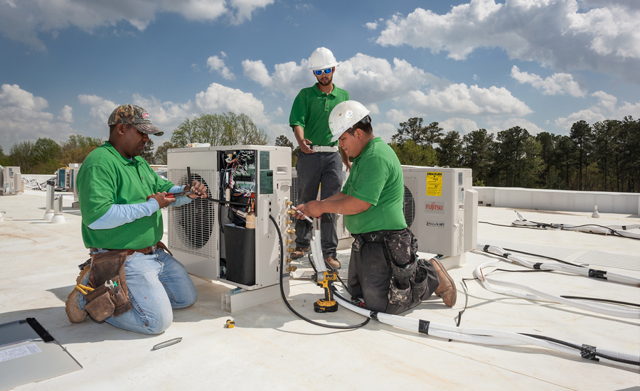 Eco Green Air employees install