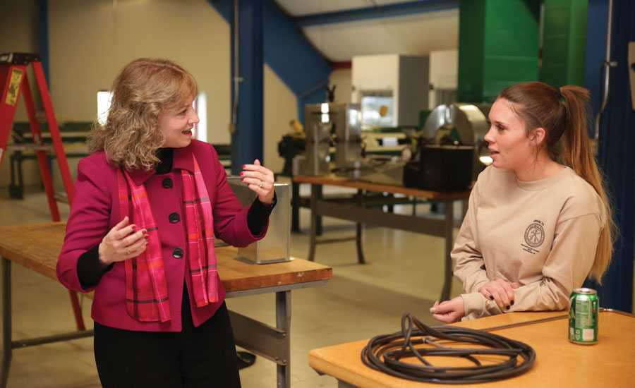Rogers (right) spoke to former Indiana schools chief Glenda Ritz (left) in 2016 when Ritz visited Local No. 20. Rogers spoke as an ambassador for apprentices, more specifically, female apprentices, in the trades. - ACHR
