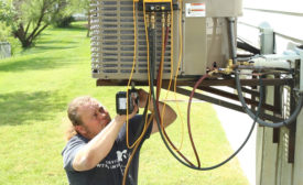 Steven Janssen, lead installer at Budget Heating, Cooling & Plumbing in St. Peters, Missouri, installs a new system for a homeowner. - ACHR