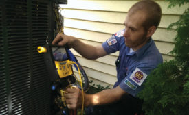 Bryan Jones, an installer at Fire and Ice Heating and Air Conditioning, Columbus, Ohio, ensures the charge is correct. - ACHR