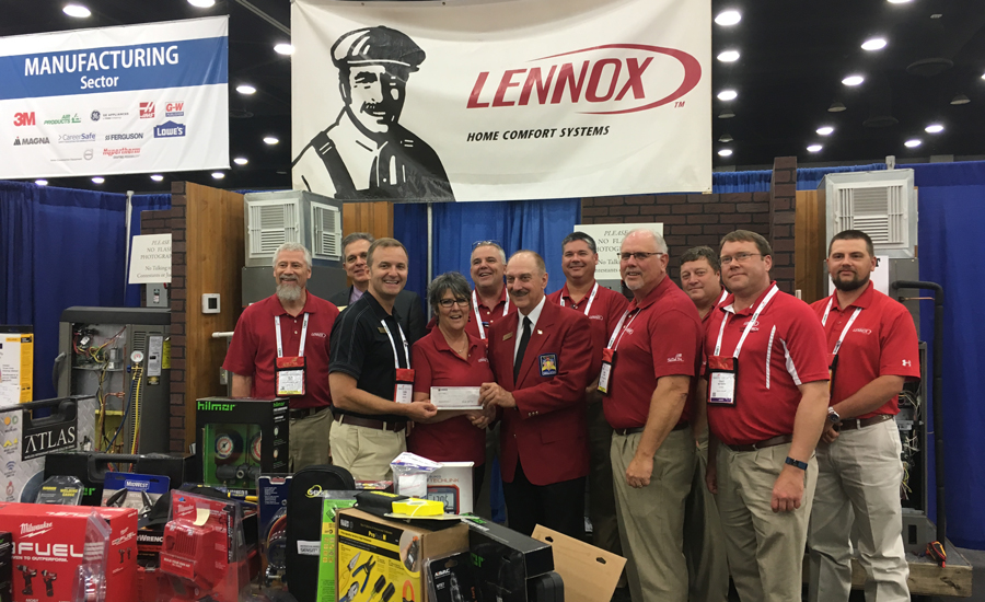 A number of red-shirted Lennox Industries field service consultants who served as judges are pictured with Michele Niekirk, also of Lennox. - The News - ACHR