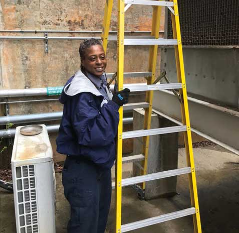 Cleaning out a refrigerated display case is Bryce Bean, a level 5 service technician with CoolSys. - The ACHR News