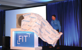 Kelly Hearnsberger, vice president, residential product marketing, Daikin, unveiled the Daikin Fit™ system to an enthusiastic crowd of distributors and Daikin Comfort Pro™ professional contractors. - The ACHR News
