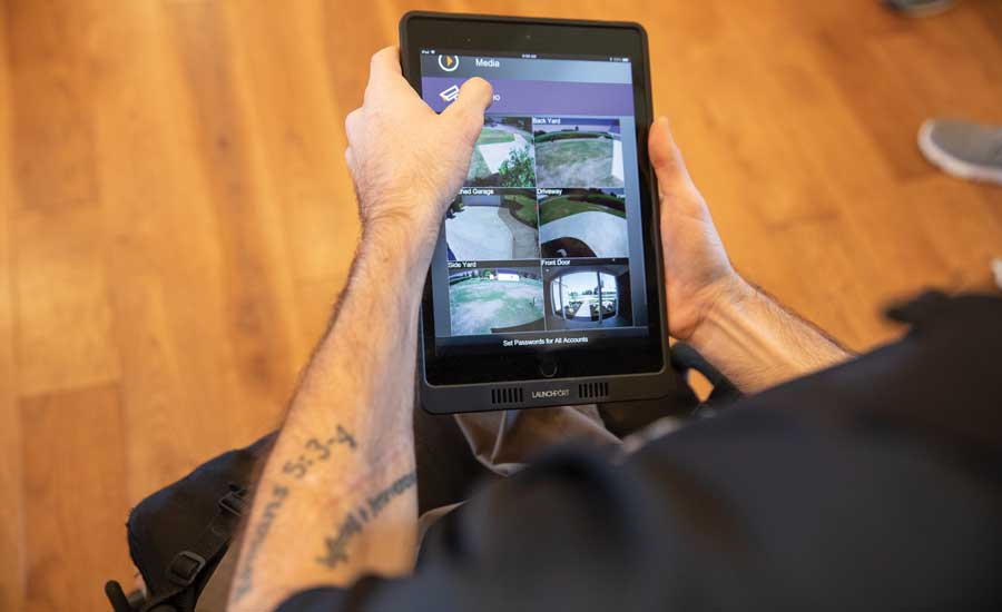 Vogt uses his iPad to view security camera footage. - The ACHR News