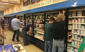 Installing doors on refrigerated cases. - ACHR News