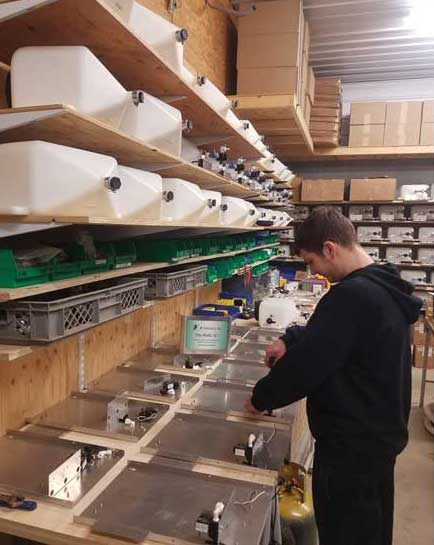 Brian Patterson inspects the JB Solutions production line. - The ACHR News