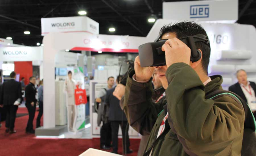 AHR Expo. Virtual reality glasses let Rehau booth visitors see behind the walls and under the floor. - The ACHR News