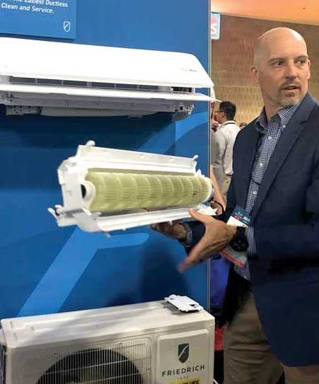 TJ Wheeler, vice president of marketing and product management for Friedrich, demonstrated how easy it is to remove the interior unit blower wheel and drain pan using FastPro. - The ACHR News