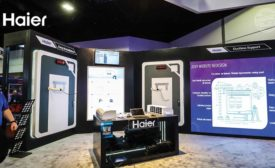 GE's booth included a sample Next GEN Arctic ductless unit, digital timer, and scoreboard as part of its Haier Ductless Easy Install competition. - The ACHR News