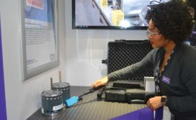 Tiana Maclin, marketing specialist, Regal Beloit, demonstrates the Genteq Electrand Wand for the Ensite motor. - The ACHR News