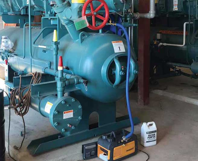 Vacuuming an ammonia chiller. - The ACHR News