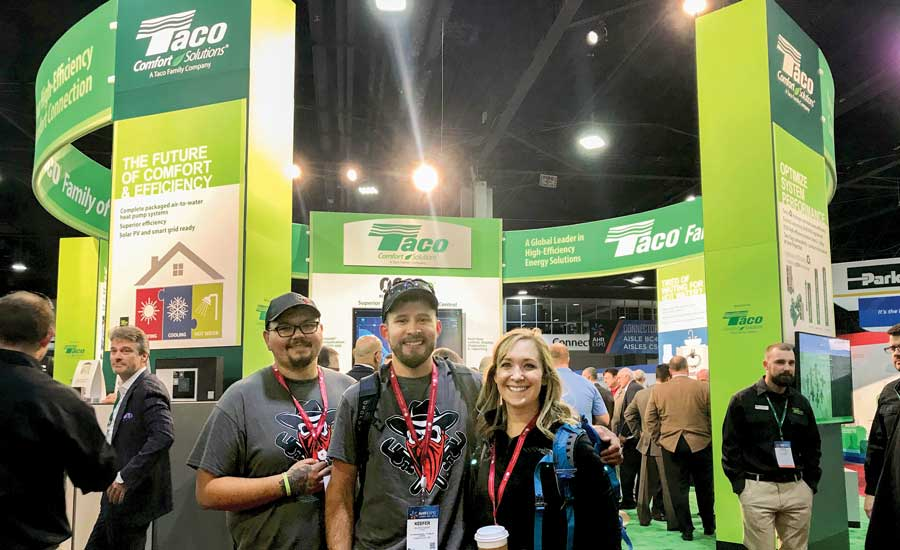 Curry (left), Keefer Rader (center), and Dorian Rader (right) discovered Taco's 0018e circulators at the company's booth. - The ACHR News