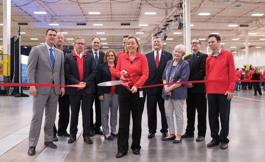 With a snip of a ribbon, Vickie Davis, plant manager, Ducted Systems, officially opened Johnson Controls' new HVAC manufacturing and testing facility. - The ACHR News