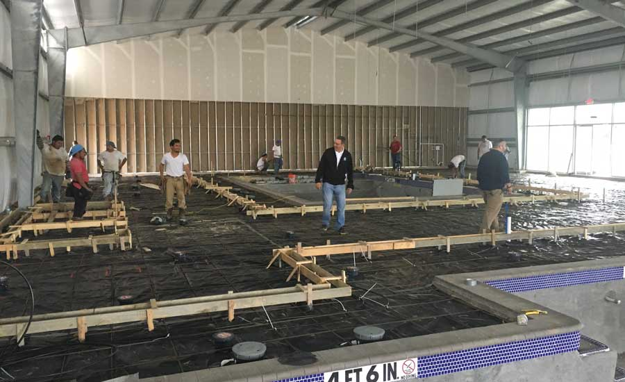 At the Fins pool complex, 3,000 feet of PureFlow PEX Barrier tubing were installed in the concrete slab. - The ACHR News