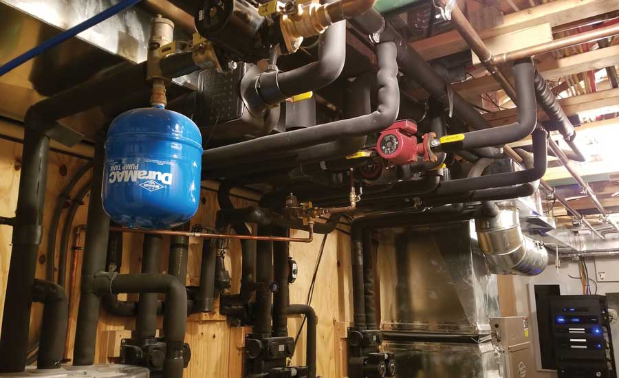 Schuster installed two hydronic air handlers, two 5-ton water-to-water geothermal units, and a 4-ton water-to-forced air unit. - The ACHR News